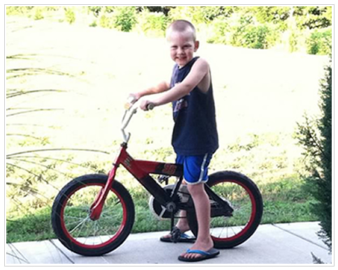 Luke riding his bike